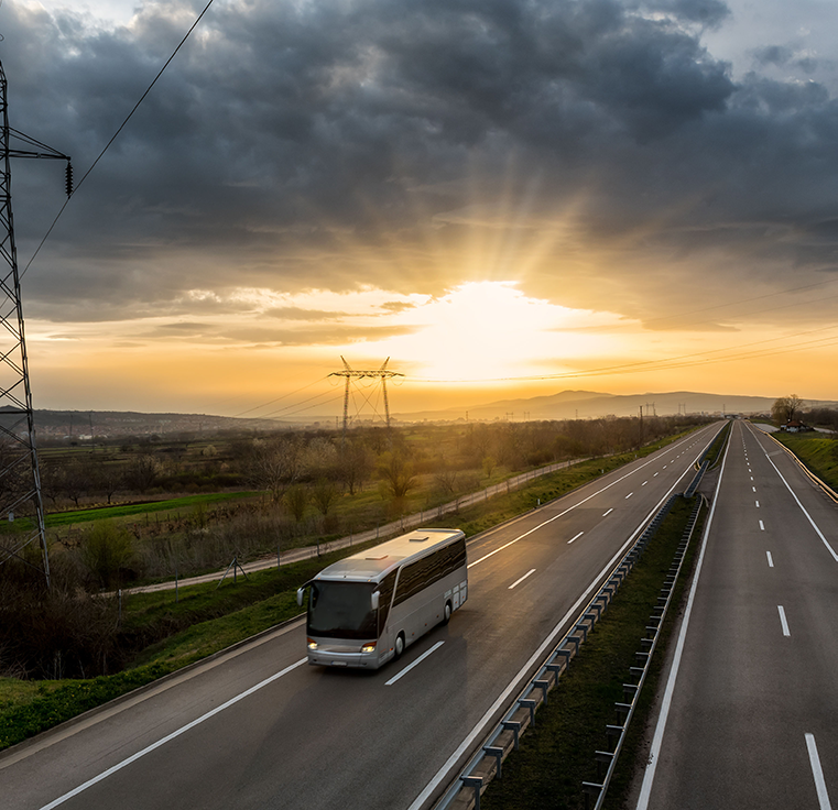 motor coach on highway at sunrise